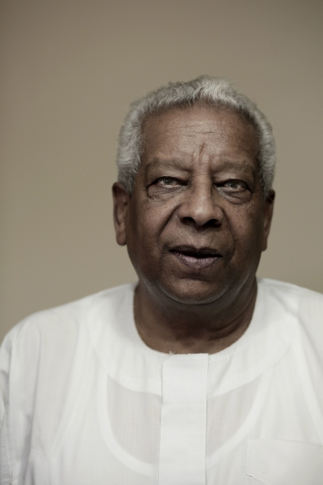 """In this Sunday, Oct. 2, 2017, photo, Haggag Oddoul poses for a photograph at his home in Alexandria, Egypt. Oddoul calls the Nubians' uprooting """" a cultural holocaust."""" Successive governments, he said, have sought to dissolve the community into the broader Arab-dominated identity, seeing any diversity as a threat and suspicious that the Nubians, if back in their lands, will seek to secede. He dismissed any doubts over Nubians' loyalties. (AP Photo/Nariman El-Mofty)"""