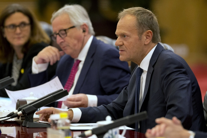 European Council President Donald Tusk, right speaks near European Commission President Jean-Claude Juncker during a meeting with Chinese Premier Li Keqiang, unseen at the Great Hall of the People in Beijing, China, Monday, July 16, 2018. The senior European Union official on Monday urged President Donald Trump, Russian President Vladimir Putin and China to work with Europe to avoid trade wars and prevent conflict and chaos.(AP Photo/Ng Han Guan, Pool)
