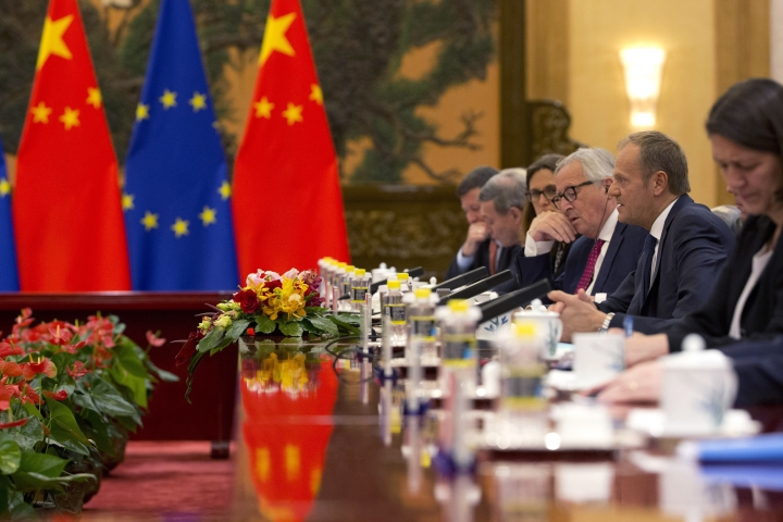 European Council President Donald Tusk, second from right and European Commission President Jean-Claude Juncker, third from right meet with Chinese Premier Li Keqiang at left at the Great Hall of the People in Beijing, China, Monday, July 16, 2018. The senior European Union official on Monday urged President Donald Trump, Russian President Vladimir Putin and China to work with Europe to avoid trade wars and prevent conflict and chaos. (AP Photo/Ng Han Guan, Pool)