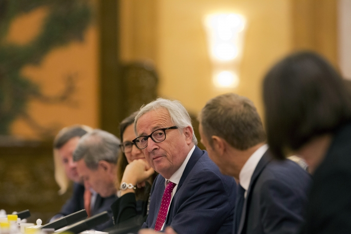 European Commission President Jean-Claude Juncker, center, looks over at European Council President Donald Tusk, second from right during a meeting at the Great Hall of the People in Beijing, China, Monday, July 16, 2018. (AP Photo/Ng Han Guan, Pool)