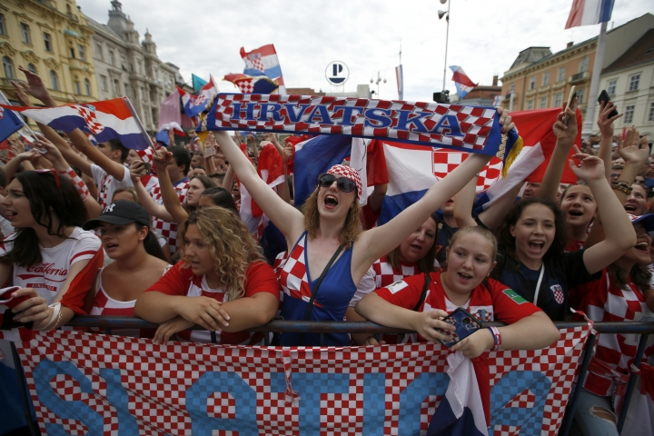 Supporter of Croatia national soccer team members wait to welcome the team on their arrival in Zagreb, Croatia, Monday, July 16, 2018. Euphoria gave way to a mixture of disappointment and pride for Croatia fans after their national team lost to France in its first ever World Cup final. (AP Photo/Darko Vojinovic)