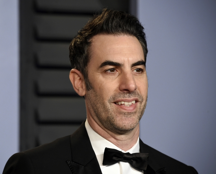 "FILE - In this March 4, 2018 file photo, Sacha Baron Cohen arrives at the Vanity Fair Oscar Party in Beverly Hills, Calif. Cohen stars in the new Showtime series ""Who Is America?"", premiering on Sunday, July 15. (Photo by Evan Agostini/Invision/AP, File)"