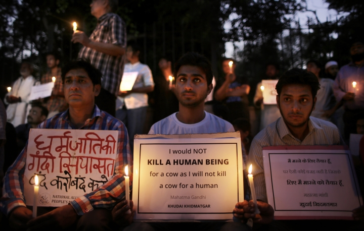 FILE- In this Oct. 3, 2015 file photo, Indians participate in a candlelight vigil in memory of 52-year-old Muslim farmer Mohammad Akhlaq who was lynched by a mob, in New Delhi, India. India's highest court on Tuesday asked the federal government to consider enacting a law to deal with an increase in mob violence and lynchings that have mostly followed rumors that the victims either belonged to members of child kidnapping gangs or were beef eaters and cow slaughterers. (AP Photo/Altaf Qadri, file)