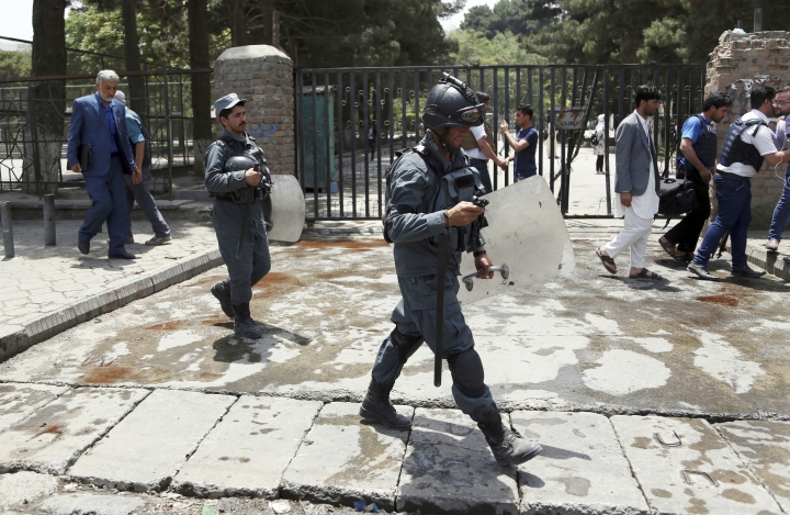 Security personnel arrived at the site of a would-be suicide attack near a park in Kabul, Afghanistan, Monday, July 16, 2018. A would-be suicide attacker was shot and killed by police in Kabul before he was able to get close to a gathering of supporters of the country's first vice president, Gen. Abdul Rashid Dostum, according to police spokesman Hashmat Stanekzai. Dostum is currently in Turkey. (AP Photo/Rahmat Gul)