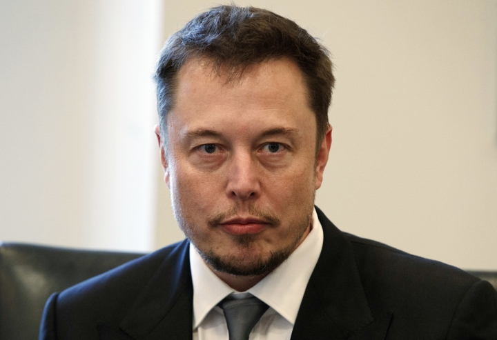 """FILE - In this Dec. 14, 2016, file photo, Tesla CEO Elon Musk listens as President-elect Donald Trump speaks during a meeting with technology industry leaders at Trump Tower in New York. Musk has apologized for calling a British diver involved in the Thailand cave rescue a pedophile. In a series of tweets late Tuesday, the Tesla CEO said he had """"spoken in anger"""" on Sunday after diver Vern Unsworth accused Musk of orchestrating a """"PR stunt"""" by sending a small submarine to help divers rescue the soccer players and their coach from a cave. (AP Photo/Evan Vucci, File)"""