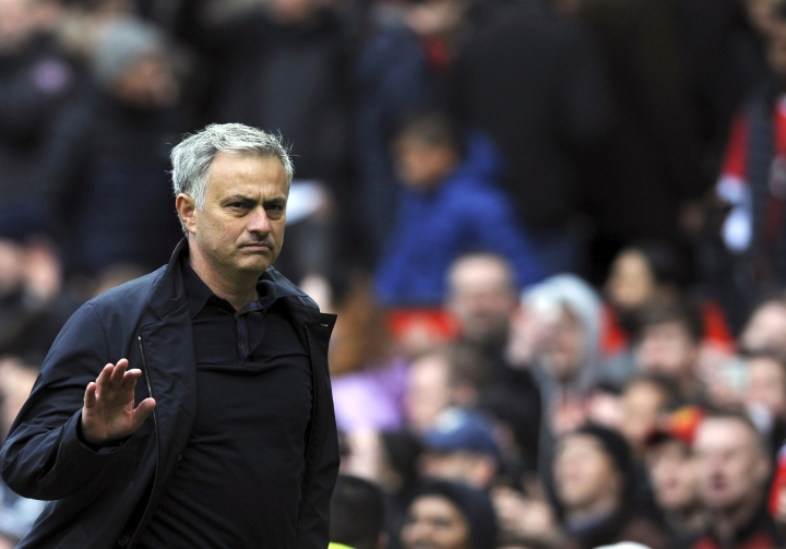 "FILE - In this file photo dated Sunday, April 29, 2018, Manchester United manager Jose Mourinho walks on the pitch at the end of the English Premier League soccer match against Arsenal at the Old Trafford stadium in Manchester, England. Mourinho on Wednesday July 18, 2018, has described the team's preseason as ""very bad"" because of the absence of key players with the disruption caused by the World Cup. (AP Photo/Rui Vieira, FILE)"