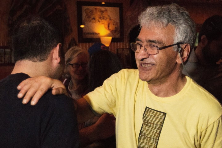 FILE - In this March 30, 2016, file photo, Ibrahim Parlak, owner of Cafe Gulistan, speaks to supporters and friends at his cafe in Harbert, Mich. Parlak, who has been facing deportation for more than a decade, learned Tuesday, July 17, 2018, that he will be allowed to stay in the U.S. Parlak was granted a deferral of removal under the Convention Against Torture, an international law protecting refugees from being returned under threat of torture or death. An immigration judge ruled that Parlak's fear for his safety upon deportation to Turkey is well-founded. (Bryan Bennett/Kalamazoo Gazette via AP)