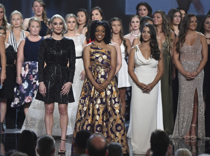 Former gymnast Sarah Klein, former Michigan State softball player Tiffany Thomas Lopez and gymnast Aly Raisman, from left in front, and others who suffered sexual abuse accept the Arthur Ashe Award for Courage at the ESPY Awards at the Microsoft Theater on Wednesday, July 18, 2018, in Los Angeles. (Photo by Phil McCarten/Invision/AP)
