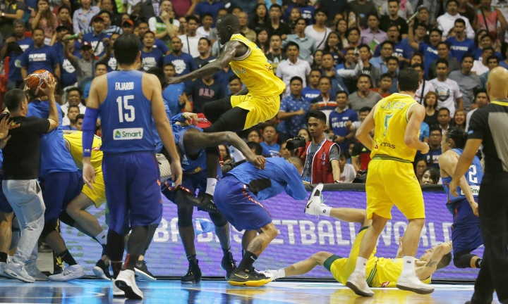 FILE - In this July 2, 2018, file photo, Philippines and Australian basketball players react during their FIBA World Cup qualifying basketball game at the Philippine Arena in suburban Bocaue township, Bulacan province, north of Manila, Philippines. Australian basketball player Daniel Kickert was given a five-match ban for unsportsmanlike behavior by international body FIBA on Thursday, July 19, 2018, for his part in a brawl during the Asian qualifier against the Philippines for the 2019 World Cup. (AP Photo/Bullit Marquez, File)