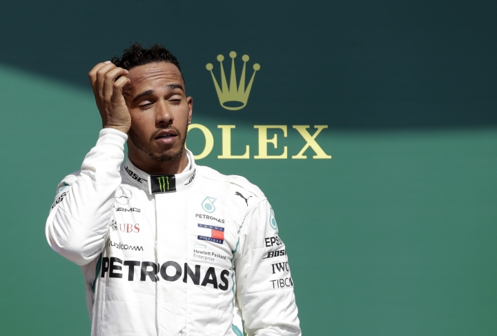Second placed Mercedes driver Lewis Hamilton of Britain gestures on the podium after the British Formula One Grand Prix at the Silverstone racetrack, Silverstone, England, Sunday, July 8, 2018. (AP Photo/Luca Bruno)