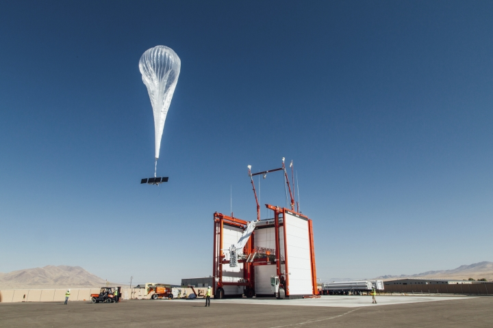 In this photo provided by Loon LLC, a balloon launches from Loon's launch site Winnemucca, Nev. Loon, the internet-delivering-balloon unit of Google-parent Alphabet, is announcing its first commercial deal. The company says it will work with partner Telkom Kenya to deliver 4G/LTE cellular access to Kenya in 2019. (Loon LLC via AP)