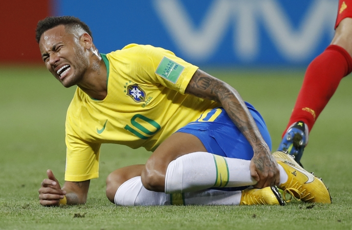 FILE - In this Friday, July 6, 2018 file photo Brazil's Neymar holds his shinbone during the quarterfinal match between Brazil and Belgium at the 2018 soccer World Cup in the Kazan Arena, in Kazan, Russia. (AP Photo/Francisco Seco, File)
