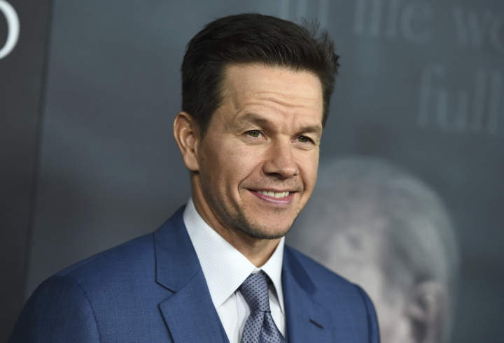 "FILE - In this Dec. 18, 2017 file photo, Mark Wahlberg arrives at the world premiere of ""All the Money in the World"" at the Samuel Goldwyn Theater in Beverly Hills, Calif. The 47-year-old actor, producer, businessman and former rapper on Thursday, July 19, 2018, announced he's launching his first car dealership, Mark Wahlberg Chevrolet in Columbus, Ohio. Wahlberg is partnering with businessman Jay Feldman, who owns eight Chevy dealerships throughout southeast and mid-Michigan. (Photo by Jordan Strauss/Invision/AP, File)"