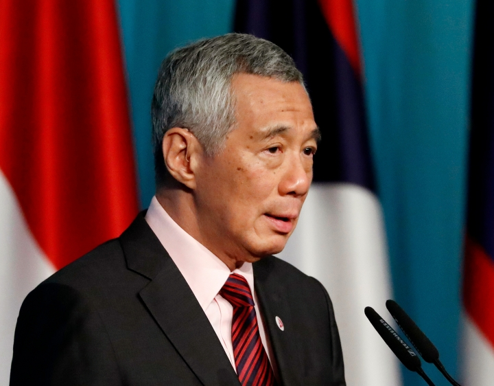 FILE - In this April 28, 2018, file photo, Singapore's Prime Minister Lee Hsien Loong speaks during a press conference to mark the end of the 32nd ASEAN Summit in Singapore. A cyberattack on Singapore's public health system breached records on 1.5 million people and targeted Prime Minister Lee, a two-time cancer survivor, officials said Friday, July 20, 2018. (AP Photo/Yong Teck Lim, File)