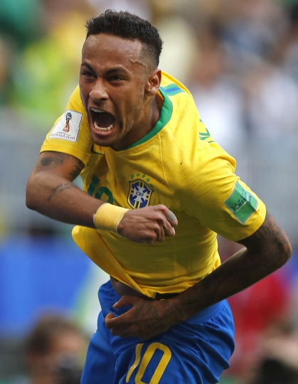 FILE - In this Monday, July 2, 2018 file photo Brazil's Neymar celebrates after scoring his side's opening goal during the round of 16 match between Brazil and Mexico at the 2018 soccer World Cup in the Samara Arena, in Samara, Russia. (AP Photo/Frank Augstein, File)