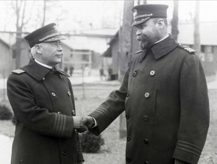 In this Feb. 25, 1919, photo provided by the Naval History and Heritage Command, Capt. Julius L. Latimer, left, bids goodbye to Cmdr. William B. Franklin after assuming command of the Pelham Bay Naval Training Station in New York. Though the Navy said in July 2018 that its servicewomen could wear longer hairstyles, servicemen have not been permitted to wear beards, which were banned in 1984. (Naval History and Heritage Command via AP)