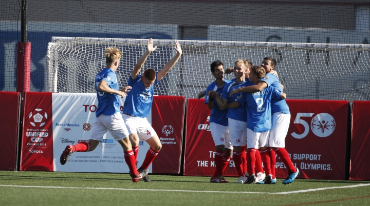 In this photo provided by Special Olympics Unified Cup, Soccer players celebrate a score during the first day of an inaugural Special Olympics Unified Cup soccer game in Chicago, Ill., Tuesday, July 17, 2018. Special Olympics hits 50-year mark of providing people with intellectual disabilities a platform to shine. The organization is celebrating its anniversary in Chicago, where Eunice Kennedy Shriver helped organize the first games (Kamil Krzaczynski/Special Olympics Unified Cup via AP)