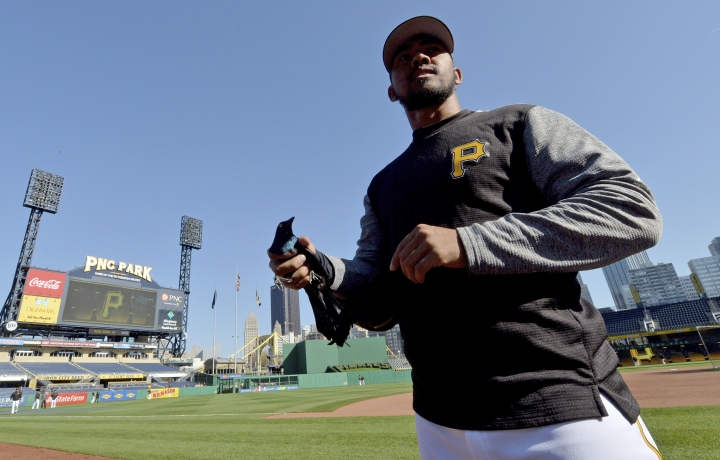 FILE - In this April 12, 2017, file photo, Pittsburgh Pirates pitcher Antonio Bastardo walks with a bird that was injured during batting practice before a baseball game against the Cincinnati Reds in Pittsburgh. Free agent Bastardo has been suspended for the rest of the season under the minor league drug program following a positive test for the steroid Stanozolol, a penalty that follows a 50-game ban five years ago for his involvement with the Biogenesis clinic. (Matt Freed/Pittsburgh Post-Gazette via AP, File)