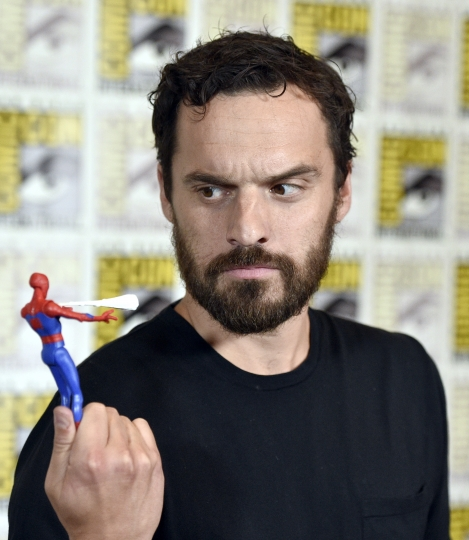 "Jake Johnson holds a figurine of Spider-man at the ""Spider-Man: Into the Spider-Verse"" press line on day two of Comic-Con International on Friday, July 20, 2018, in San Diego. (Photo by Chris Pizzello/Invision/AP)"