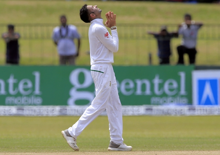 South Africa's Keshav Maharaj celebrates after taking the ninth Sri Lankan wicket during the second day's play of their second test cricket match in Colombo, Sri Lanka, Saturday, July 21, 2018. (AP Photo/Eranga Jayawardena)