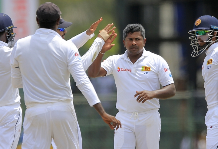 Sri Lanka's Rangana Herath, second right, celebrates with teammates the dismissal of South Africa's Aiden Markram during the second day's play of their second test cricket match in Colombo, Sri Lanka, Saturday, July 21, 2018. (AP Photo/Eranga Jayawardena)
