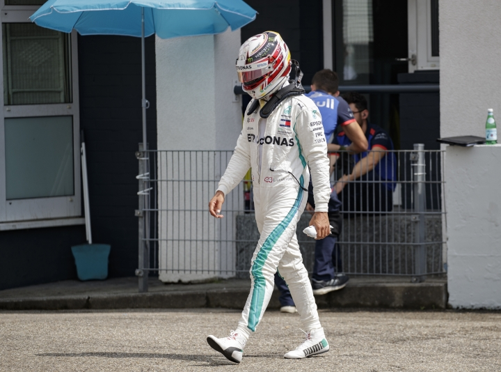 British Formula One driver Lewis Hamilton of Mercedes AMG GP walks through the pit lane after he retired during the qualifying session at the Hockenheimring in Hockenheim, Germany, 21 July 2018. The 2018 Formula One Grand Prix of Germany will take place on 22 July. (AP Photo/Pool Photo via AP)