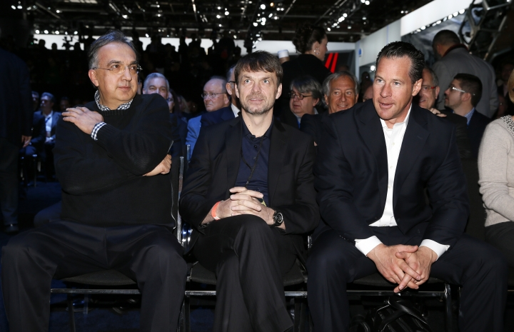 """FILE - In this Tuesday, Jan. 13, 2015 file photo, Sergio Marchionne, left, Chief Executive Officer, Fiat Chrysler Automobiles; Michael Manley, President and Chief Executive Officer, Jeep Brand and Reid Bigland, President and CEO of Alfa Romeo, North America watch at media previews for the North American International Auto Show in Detroit. Fiat Chrysler Automobiles' board of directors has recommended that Jeep executive Mike Manley replace seriously ill Sergio Marchionne as CEO of the automaker. A company statement said the decision was made at an urgently convened board meeting Saturday, July 21, 2018 because Marchionne's health had suddenly deteriorated following recent surgery and he """"will be unable to return to work."""" (AP Photo/Paul Sancya, File)"""