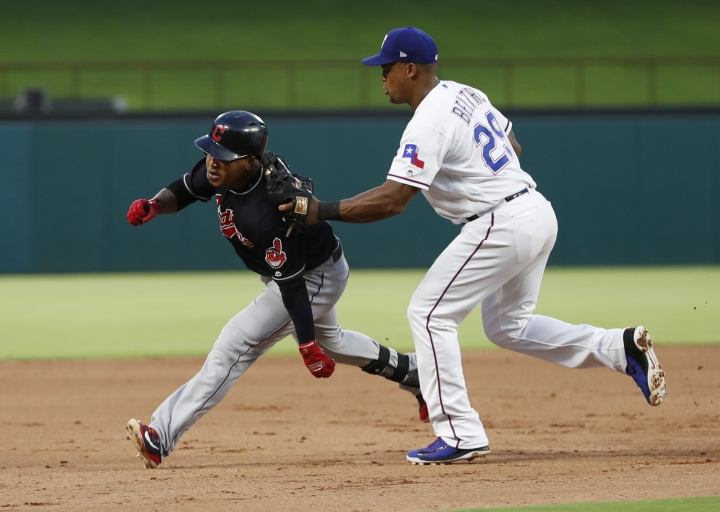 Cleveland Indians' Jose Ramirez, left, is tagged out by Texas Rangers third baseman Adrian Beltre (29) as Ramirez attempted to reach third after a single and a fielding error during the fifth inning of a baseball game, Saturday, July 21, 2018, in Arlington, Texas. (AP Photo/Jim Cowsert)