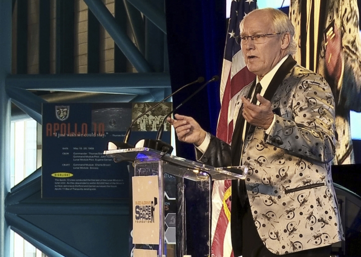 FILE - In this July 15, 2017, file photo, Andrew Aldrin, Apollo 11 astronaut Buzz Aldrin's son, speaks at the commemoration for the upcoming anniversary of the 1969 mission to the moon and a gala for the non-profit space education foundation, ShareSpace Foundation, at the Kennedy Space Center in Cape Canaveral, Fla. Aldrin is expected to be noticeably absent from a gala kicking off a yearlong celebration of the 50-year anniversary of the first moon landing, even though his foundation is a sponsor and he typically is the star attraction. Organizers haven't heard one way or another if Aldrin is attending Saturday, July 21, 2018 evening's Apollo Celebration Gala at the Kennedy Space Center in Florida, but they expect him to be a no-show. (AP Photo/Alex Sanz, File)