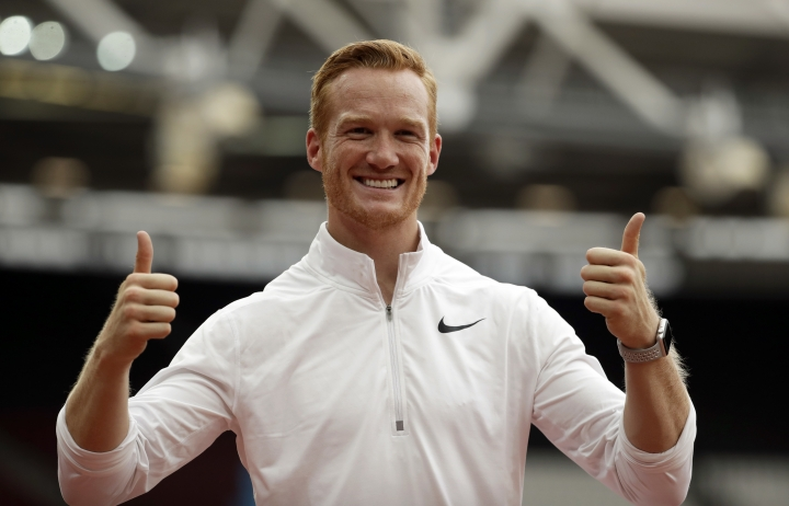 Greg Rutherford of Great Britain poses for photos after competing in the men's long jump event at the IAAF Diamond League athletics meeting at London Stadium in London, Sunday, July 22, 2018. (AP Photo/Matt Dunham)