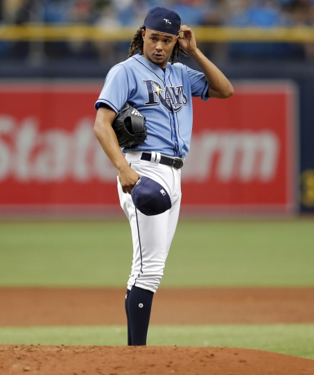 Tampa Bay Rays starting pitcher Chris Archer reacts after giving up the fourth run of the second inning of a baseball game against the Miami Marlins Sunday, July 22, 2018, in St. Petersburg, Fla. (AP Photo/Mike Carlson)