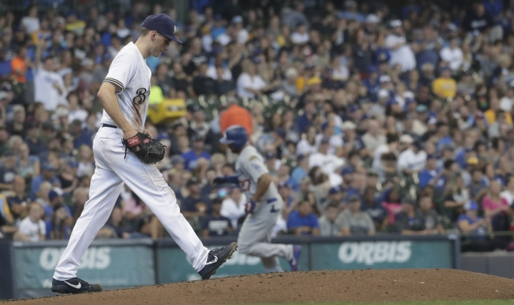 Milwaukee Brewers' Zach Davies walks back to the mound after giving up a home run to Los Angeles Dodgers' Matt Kemp during the third inning of a baseball game Sunday, July 22, 2018, in Milwaukee. (AP Photo/Morry Gash)