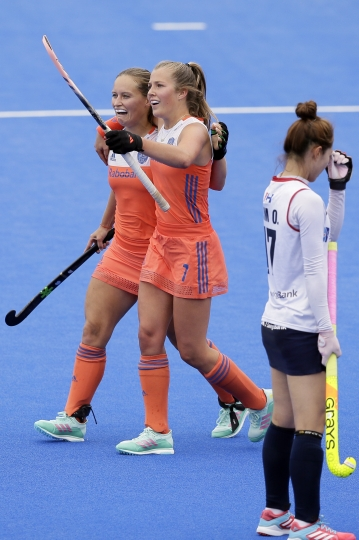 The Netherlands' Kelly Jonker, left, celebrates after scoring a goal with the Netherlands' Xan de Waard during the group stage match between the Netherlands' and Korea in the Women's Hockey World Cup at the at the Lee Valley Hockey and Tennis Centre in London, Sunday July 22, 2018. (AP Photo/Tim Ireland)
