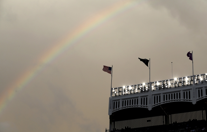 A rainbow appears over Yankee Stadium before a baseball game between the New York Yankees and the New York Mets, Sunday, July 22, 2018, in New York. (AP Photo/Seth Wenig)