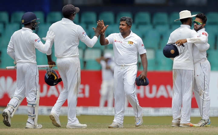 Sri Lanka's Rangana Herath, center, celebrates with teammates after their win over South Africa on the fourth day of their second test cricket match in Colombo, Sri Lanka, Monday, July 23, 2018. Sri Lanka won the series 2-0. (AP Photo/Eranga Jayawardena)