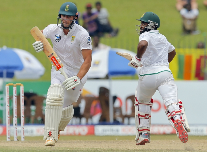 South Africa's Theunis de Bruyn, left, and Temba Bavuma run between wickets during the fourth day's play of their second test cricket match against Sri Lanka in Colombo, Sri Lanka, Monday, July 23, 2018. (AP Photo/Eranga Jayawardena)