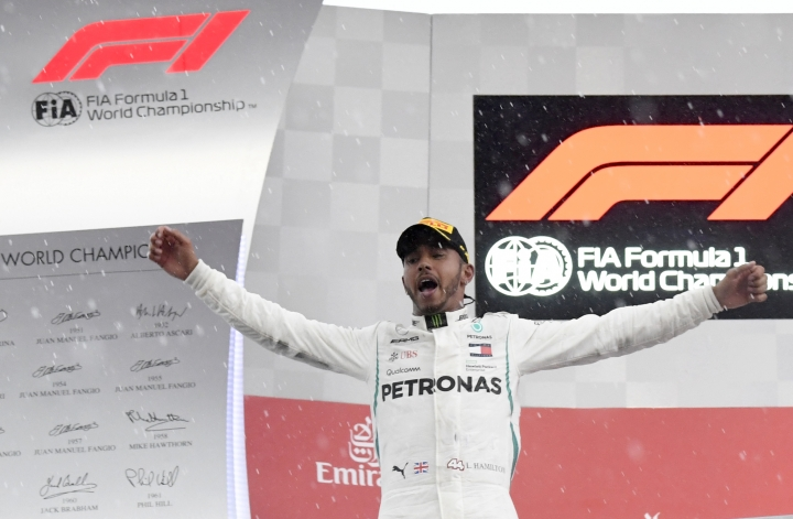Mercedes driver Lewis Hamilton of Britain celebrates on the podium after winning the German Formula One Grand Prix at the Hockenheimring racetrack in Hockenheim, Germany, Sunday, July 22, 2018. (AP Photo/Jens Meyer)