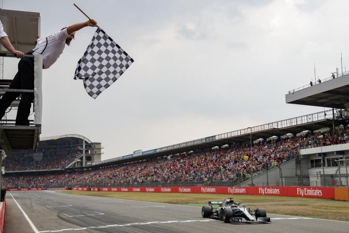 British Formula One driver Lewis Hamilton of Mercedes AMG GP crosses the finish line of the 2018 Formula One Grand Prix of Germany at the Hockenheimring in Hockenheim, Germany, July 22, 2018. (AP Photo/Pool Photo via AP)
