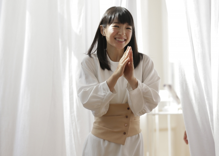 In this July 11, 2018 photo, Japanese organizational expert Marie Kondo appears at a media event to introduce her new line of storage boxes in New York. Kondo is launching the product line, a six-piece set of colorful and sturdy paper boxes, for $89. (AP Photo/Seth Wenig)
