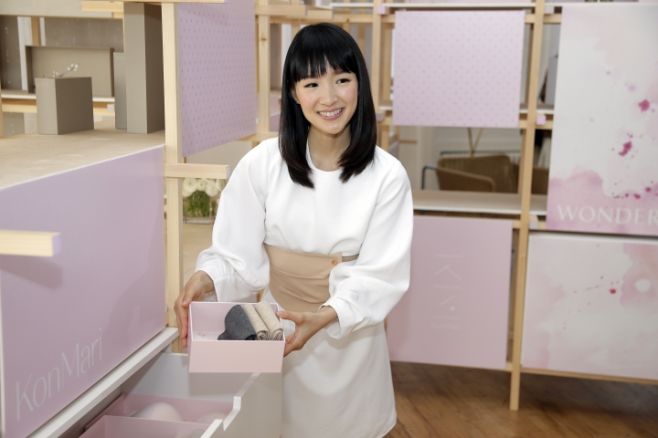 In this July 11, 2018 photo, Japanese organizational expert Marie Kondo introduces her new line of storage boxes during a media event in New York. Kondo is launching the product line, a six-piece set of colorful and sturdy paper boxes, for $89. (AP Photo/Seth Wenig)