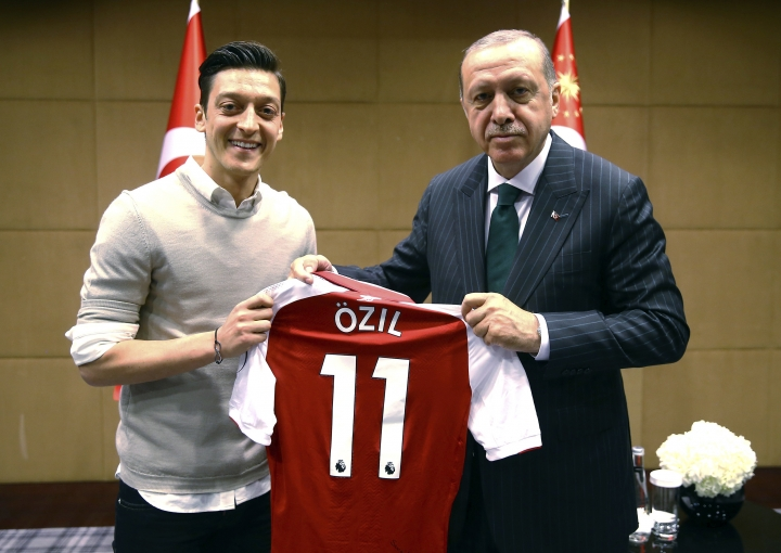 FILE - In this file photo taken on Sunday, May 13, 2018, Turkey's President Recep Tayyip Erdogan, right, poses for a photo with Arsenal soccer player Mesut Ozil in London. Germany midfielder Ozil has announced his retirement from international soccer, alleging racial discrimination. (Presidential Press Service/Pool via AP, File)