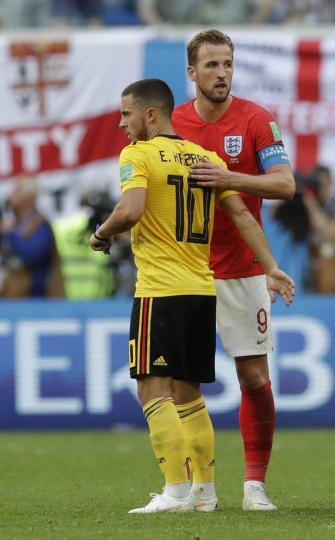 England's Harry Kane, right, embraces Belgium's Eden Hazard following the third place match between England and Belgium at the 2018 soccer World Cup in the St. Petersburg Stadium in St. Petersburg, Russia, Saturday, July 14, 2018. (AP Photo/Petr David Josek)