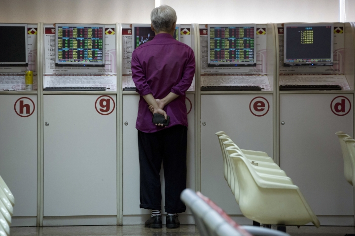 An investor monitors stock prices at a brokerage in Beijing, China, Wednesday, July 25, 2018. Asian stock markets were mostly higher Wednesday after Wall Street gained on strong corporate earnings. (AP Photo/Ng Han Guan)