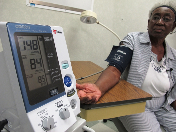 "Margaret Graham, 74, has her blood pressure checked while visiting the Wake Forest Baptist Medical Center in Winston-Salem, N.C., on Friday, July 13, 2018. She had participated in a multi-year study, published on Wednesday, July 25, 2018, investigating a connection between high blood pressure and the risk of mental decline. ""I feel like maybe with this study, some findings may come that will develop new drugs and also new activities, exercise, theories that will help people to maintain an acceptable blood pressure level,"" Graham says. (AP Photo/Allen G. Breed)"