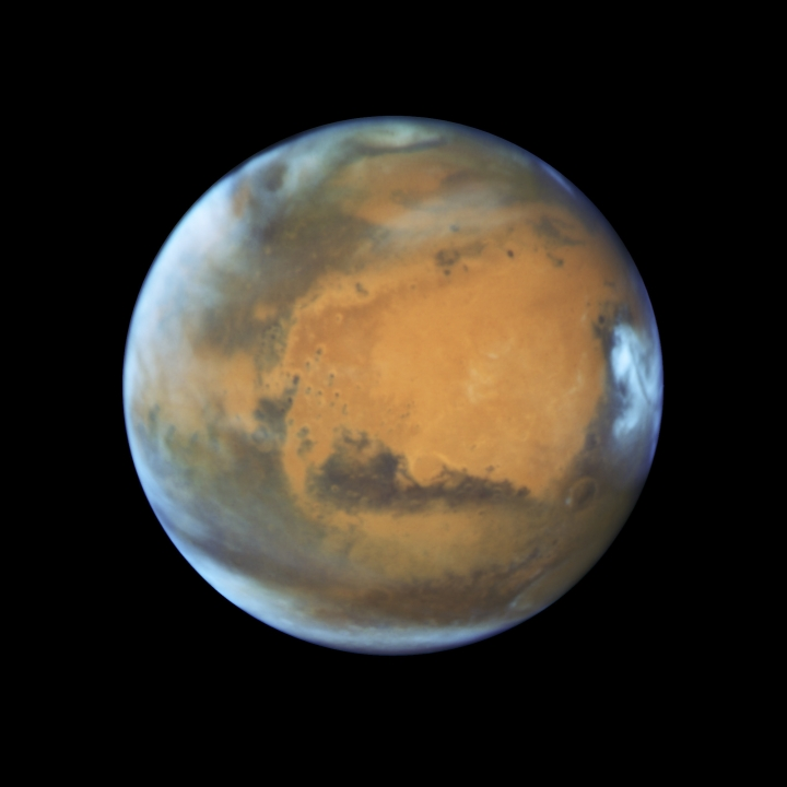 This May 12, 2016 image provided by NASA shows the planet Mars. A study published Wednesday, July 25, 2018 in the journal Science suggests a huge lake of salty water appears to be buried deep in Mars, raising the possibility of finding life on the red planet. (NASA/ESA/Hubble Heritage Team - STScI/AURA, J. Bell - ASU, M. Wolff - Space Science Institute via AP)
