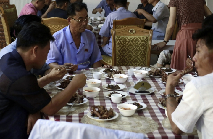 "Food are served on a table during the lunch time at Pyongyang House of Sweet Meat, a restaurant specialized in dishes made of dog meat, in Pyongyang, North Korea, Wednesday, July 25, 2018. Euphemistically known as ""dangogi,"" or sweet meat, dog has long been believed to be a stamina food in North and South Korea and is traditionally eaten during the hottest time of the year, giving a sad twist to old saying ""dog days of summer."" (AP Photo/Dita Alangkara)"