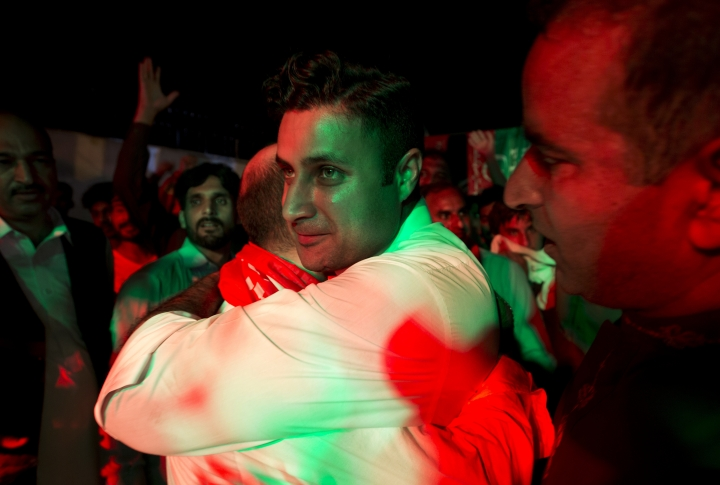 Supporters of Pakistani politician Imran Khan, chief of Pakistan Tehreek-e-Insaf party, celebrate projected unofficial results that were announced by television channels indicating their candidates' success in the parliamentary elections in Islamabad, Pakistan, Wednesday, July 25, 2018. (AP Photo/B.K. Bangash)