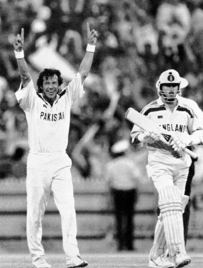 FILE - In this March 25, 1992 file photo, Pakistan captain Imran Khan, left, raises his arms in triumph, as England's last batsman Richard Illingworth, right, walks away after being given out, during the World Cup Cricket Final, in Melbourne, Australia. He won the cricket World Cup for Pakistan in 1992 when the country's prime minister was Nawaz Sharif. Twenty six years later the charismatic Imran Khan is all set to become the first cricketer in the world to be elected as a country's prime minister in Wednesday, July 25, 2018 elections. (AP Photo/Ross Setford)