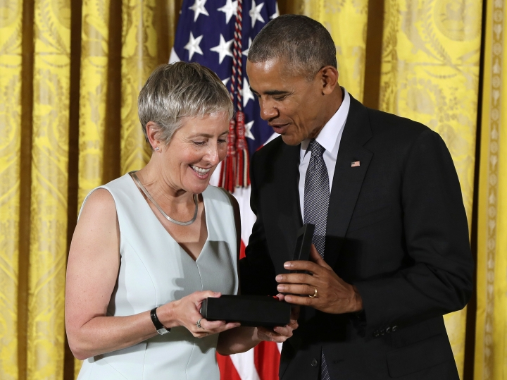 FILE - In this Sept. 22, 2016 file photo, President Barack Obama awards Jody Lewen, the executive director of Prison University Project at San Quentin State Prison, the 2015 National Humanities Medal during a ceremony at the White House in Washington. White House ceremonies for arts and science medal winners, a tradition dating back to the 1980s, have been absent so far in the Trump administration. Eighteen months into Trump's presidency, there have been no National Science Medals, or National Medals of Arts or National Medals of Humanities. The medals are personally bestowed by the president. (AP Photo/Carolyn Kaster, File)