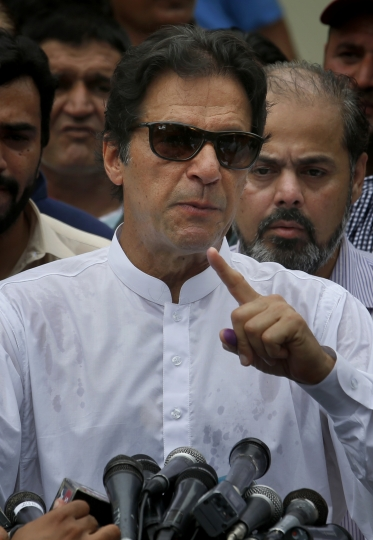 Pakistani politician Imran Khan, chief of Pakistan Tehreek-e-Insaf party, speaks to media after casting his vote at a polling station for the parliamentary elections in Islamabad, Pakistan, Wednesday, July 25, 2018. After an acrimonious campaign, polls opened in Pakistan on Wednesday to elect the country's third straight civilian government, a first for this majority Muslim nation that has been directly or indirectly ruled by its military for most of its 71-year history. (AP Photo/Anjum Naveed)